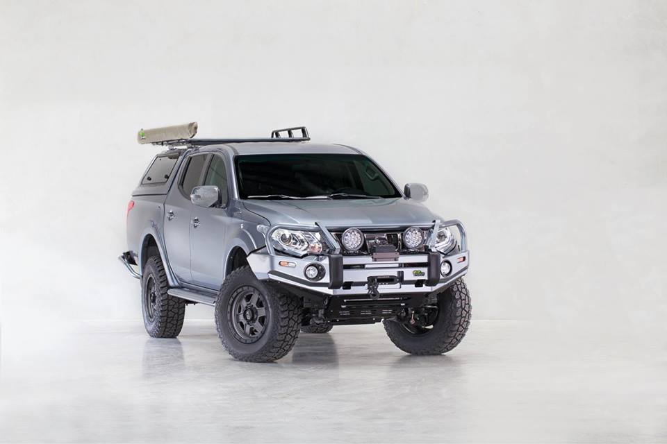 เอาใจเจ้าของรถ Mitsubishi Tritonอุปกรณ์ตกแต่งครบเซ็ท ของ Ironman 4x4 Featuring- Colour coded Commercial Deluxe Bull Bar- Colour coded Side Steps- Monster Winch- Driving Lights- Snorkel- Colour coded Rear Protection Tow Bar- Colour coded Canopy- Roof rack- Awning- Suspension upgrade